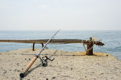 Fishing rod on the beach stock photo