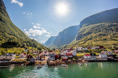Beautiful Fishing village Undredal against mountain near the Flam in Norway. Fishing village Undredal close the fjord near the Flam in Norway Royalty Free Stock Image