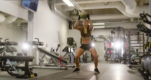 Athletic female doing high-intensity bouncy jump training stock video