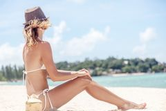 Beautiful fit body girl on travel vacation. bikini body wom. An playful on paradise tropical beach royalty free stock photos