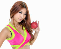 Beautiful fit Chinese woman holding an apple Royalty Free Stock Photo
