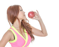 Beautiful fit Chinese woman holding an apple Royalty Free Stock Images