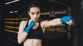 Beautiful and fit female fighter getting prepared for the fight or training royalty free stock images