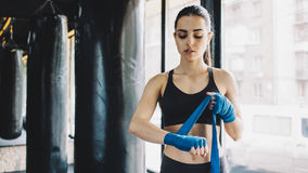 Beautiful and fit female fighter getting prepared for the fight or training stock photos