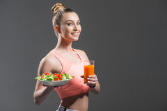 Beautiful fit girl is dieting with healthy food Stock Photography