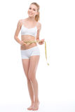 Beautiful fit girl with measuring tape Royalty Free Stock Image