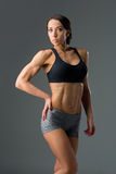 Beautiful fit girl in sport bra and shorts Stock Photos