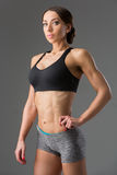 Beautiful fit girl in sport bra and shorts Stock Photography