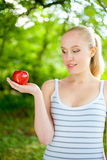 Beautiful fit and healthy woman holding an apple Royalty Free Stock Images