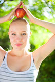 Beautiful fit and healthy woman holding an apple Stock Images
