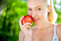 Beautiful fit and healthy woman holding an apple Stock Image