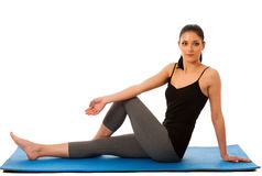 Beautiful fit hispanic woman doing stretching excercise isolated Stock Photo