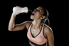 Beautiful and fit latin sport woman drinking water tired during Royalty Free Stock Photography