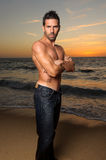 Beautiful fit man at the beach Royalty Free Stock Image
