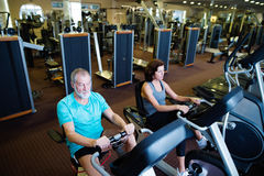 Beautiful fit senior couple in gym doing cardio work out. Royalty Free Stock Photography