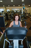 Beautiful fit senior woman in gym doing cardio work out. Stock Images