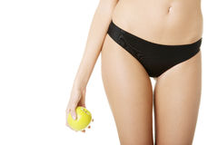 Beautiful fit sensual female body and apple Stock Images