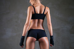Beautiful fit, sexy female body on dark grey Royalty Free Stock Photos