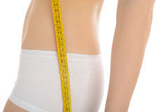 Beautiful fit slim woman body measuring hips Stock Image