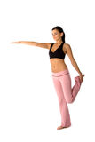 Beautiful fit woman. Beautiful young and fit woman is stretching before her workout Royalty Free Stock Images