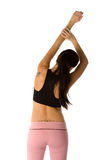 Beautiful fit woman. Beautiful young and fit woman is stretching before her workout Stock Photos