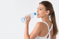 Woman drinking water from blue bottle Royalty Free Stock Photos