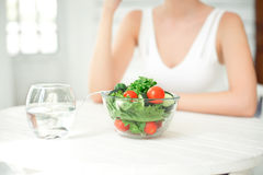 Beautiful fit woman eating healthy salad. royalty free stock photo