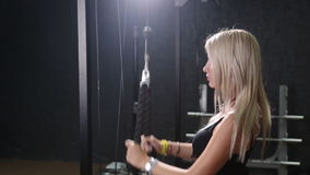 Beautiful fit woman exercising building muscles. Beautiful muscular fit woman exercising building muscles stock video