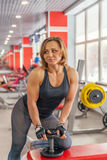 Beautiful fit woman exercising building muscles Royalty Free Stock Images