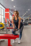 Beautiful fit woman exercising building muscles Royalty Free Stock Image