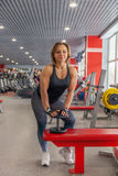 Beautiful fit woman exercising building muscles Royalty Free Stock Photos