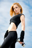 Beautiful fit woman exercising  outdoors Royalty Free Stock Photos