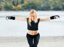 Beautiful fit woman exercising outdoors Stock Photography