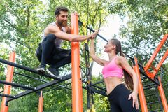Beautiful fit woman giving high-five to her workout partner royalty free stock image