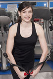Beautiful fit woman at the gym smiling Royalty Free Stock Photography