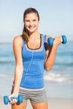 Beautiful fit woman holding dumbbells Royalty Free Stock Photos