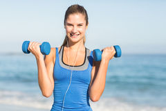 Beautiful fit woman holding dumbbells Stock Image