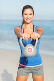 Beautiful fit woman holding dumbbells Royalty Free Stock Photography