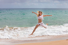 Beautiful Fit Woman Jumping out of the water Royalty Free Stock Photo