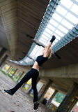 Beautiful fit woman lifting weights outdoors Royalty Free Stock Images