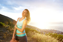 Beautiful fit woman standing outdoors Stock Images