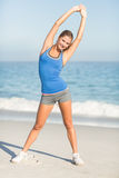 Beautiful fit woman stretching her arms Royalty Free Stock Photo