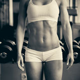 Beautiful fit woman working out in gym - girl in fitness Royalty Free Stock Images