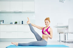 Beautiful Fit Woman Working out at Home stock image