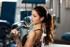 Beautiful fit woman works out in a fitness gym Royalty Free Stock Photos