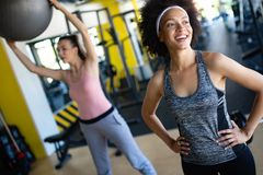 Beautiful fit women exercising together in gym. Beautiful happy women exercising together in gym royalty free stock photos