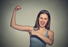 Beautiful fit young healthy model woman flexing muscles showing her strength. Closeup portrait beautiful fit young healthy model woman flexing muscles showing Royalty Free Stock Photos