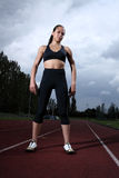 Beautiful fit young woman athlete on running track Stock Image