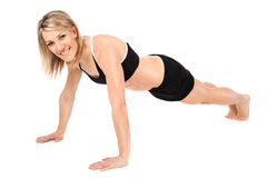 Beautiful fit young woman doing push ups Stock Image