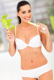 Fit woman celery Stock Image